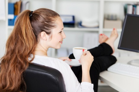Woman taking a coffee break in her office